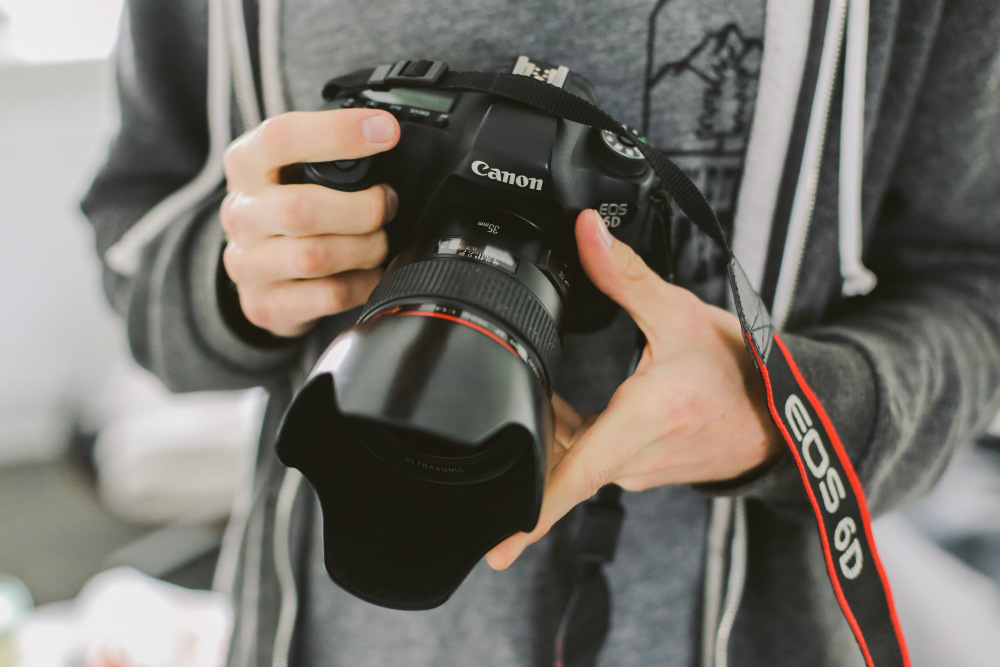 Professional photographer with Canon DSLR camera
